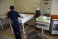 2 August 2011, Teyateyaneng Hospital, Berea District, Lesotho. One of the labour nurses are giving the newborn baby his first dose of Nevaropine. His mother, Malindiwe Pheko, 35 years old is an HIV-positive mother who gave birth to her 3rd child, a boy born at 12.10 pm weighing 4.1kg. The other two girls are HIV-negative.