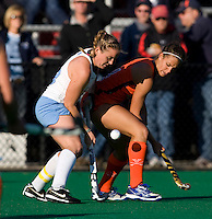 Elizabeth Drazdowski (18) of UNC fights for the ball with Paige Selenski (21) of Virginia during the NCAA Field Hockey Championship semfinals in College Park, MD.  North Carolina defeated Virginia, 4-3, in overtime.