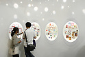 July 9, 2010 - Tokyo Japan - People look at Christmas cards on display at the International Stationery & Office Products Fair Tokyo, Japan, on July 9, 2010. Japan is the world's 2nd largest market for stationery, office products and gift items, and numbers of key buyers from across the country converge at Tokyo Big Sight to source products on-site.