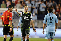 Jack Jewsbury (13) midfielder Portland Timbers questions referee's call... Sporting Kansas City defeated Portland Timbers 3-1 at LIVESTRONG Sporting Park, Kansas City, Kansas.