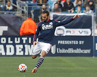 New England Revolution defender A.J. Soares (5) passes the ball.  In a Major League Soccer (MLS) match, the New England Revolution (blue/white) tied Vancouver Whitecaps FC (white), 0-0, at Gillette Stadium on March 22, 2014.