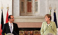Il Presidente francese Francois Hollande ed il Cancelliere tedesco Angela Merkel, a destra, si guardano durante la conferenza stampa congiunta al termine del Vertice Quadrilaterale fra Italia, Spagna, Francia e Germania, a Villa Madama, Roma, 22 giugno 2012..French President Francois Hollande and German Chancellor Angela Merkel, right, look each other during the joint press conference at the end of the Quadrilateral Summit among Italy, Spain, France and Germany, at Villa Madama, Rome, 22 june 2012..UPDATE IMAGES PRESS/Riccardo De Luca