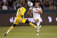 Landon Donovan (10) of the LA Galaxy blows past Bouna Coundoul (18) New York Red Bulls goal keep, but narrowly missed and open net goal. Red BullThe LA Galaxy and Red Bulls of New York played to a 1-1 tie at Home Depot Center stadium in Carson, California on  May 7, 2011....