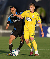 Robbie Rogers of the Crew controls the ball away from Ramiro Corrales of Earthquakes during the first half of the game at Buck Shaw Stadium in Santa Clara, California.  San Jose Earthquakes tied Columbus Crew, 2-2.