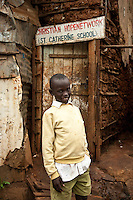 Nairobi, June 2010 -    A boy who lives at the St. Catherine's children's home was asked by the directors to be in a photo standing in front of their children The fome.