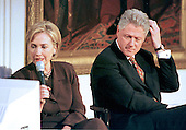 First lady Hillary Rodham reads a viewer's question during the live broadcast of the &quot;Millennium Evening Lecture Series&quot; from The East Room of The White House in Washington, DC as United States President Bill Clinton looks on,18 September, 1998.<br /> Credit: Ron Sachs / CNP