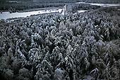 Niegowa 01.2010 Poland<br /> View from the silo to the frozen and icy woods.<br /> Three atmospheric forces: rain, snow and frost have changed into an ecological disaster the Myszkowski district in the Czestochowskie province,<br /> located 230 kilometers south of Warsaw. Almost 95% of all trees are down.Thousands of homes are left without electricity.<br /> Photo: Adam Lach / Napo Images for Newsweek Polska<br /> <br /> Widok z silosu na zamarzniete i zlodowaciale lasy.<br /> Wstepnie &quot;tylko&quot; 95% scietych drzew w dwoch powiatach. 0.5 miliona metrow szesciennych zniszczonych lasow..Tysiace gospodarstw bez pradu. Wszyscy maja swiadomosc, ze na kumulacje trzech niekorzystnych .zjawisk atmosferycznych rady nie ma.Trzy zjawiska kt&oacute;re zamienily jeden z obszarow Polski w istna katastrofe ekologiczna: deszcz, snieg i szadz.<br /> Fot: Adam Lach / Napo Images dla Newsweek Polska