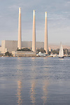 Morro Bay, California; the power plant and smoke stacks reflect in Morro Bay in late afternoon sunlight