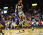 "Ole Miss' Murphy Holloway (31) shoots over LSU's Malcolm White (5) at the C.M. ""Tad"" Smith Coliseum in Oxford, Miss. on Saturday, February 25, 2012. (AP Photo/Oxford Eagle, Bruce Newman).."