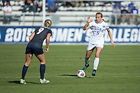 Cary, North Carolina - Sunday December 6, 2015: Rebecca Quinn (5) of the Duke Blue Devils looks to keep the ball away from Frannie Crouse (9) of the Penn State Nittany Lions during first half action at the 2015 NCAA Women's College Cup at WakeMed Soccer Park.  The Nittany Lions defeated the Blue Devils 1-0.