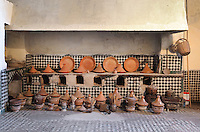 Kitchen of the Glaoui Palace, early 19th century, in Fes, Fes-Boulemane, Northern Morocco. The long tiled oven area is covered with traditional terracotta tagines, cooking pots and utensils. Thami Glaoui, Pasha of Marrakech, used this as his Fes residence. The complex consists of 30 fountains, 17 houses, 2 hammams, an oil mill, a mausoleum and cemetery, a madrasa, gardens and stables. Picture by Manuel Cohen