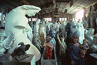 "April 27, 1990, Rome, Italy. Photographing for the book ""One day in the life of Italy"", this is an exploration of Rome. In Cinecitta, at the D'Angelis Sculpture warehouse, props such as the bust of Mussolini are stored."