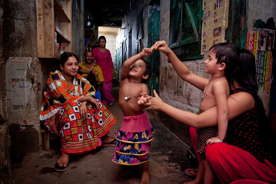 "Faridpur Brothel is the second to largest brothel in Bangladesh. (17 registered brothels in the country) 600+ girls live in a hidden neighboorhood accesible through one of the six alleyways, covered with small ragged curtains mimicking doors. Many girls are under aged - the ""legal"" age being 18. The chhukris live in a small radius around their room  24h/7 365 days a year. March 15, 2011. Gabriela Barnuevo"