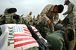 A few days before they begin the journey back to the United States after eight months in Najaf, Iraq, Marines with Charlie Co. 1st Battalion 4th Marines pack their gear for the trip to Kuwait on January 31, 2005.