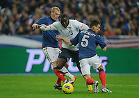 Jeremy Mathieu of France, Jozy Altidore of team USA and Laurent Koscielny of France fight for the ball during the friendly match France against USA at the Stade de France in Paris, France on November 11th, 2011.
