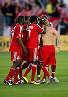 01 July 2010:  Toronto FC players celebrate the equalizing goal by Toronto FC defender Dan Gargan #8, shirtless, in the eighty fourth minute during a game between the Houston Dynamo and the Toronto FC at BMO Field in Toronto..Final score was 1-1....