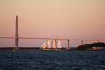 Schooner Pride Sailboat Sailing the Charleston Harbor during Sunset Arthur Ravenel Jr Bridge castle Pinckney