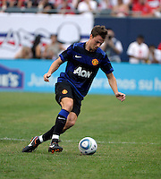 Manchester United defender Jonny Evans (23) dribbles in the open field.  Manchester United defeated the Chicago Fire 3-1 at Soldier Field in Chicago, IL on July 23, 2011.