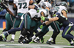 Seattle Seahawks outside linebacker K.J. Wright (50) and  outside linebacker Brock Coyle (52) holds Philadelphia Eagles running back Ryan Mathews (24) for a one-yard gain at CenturyLink Field in Seattle, Washington on November 20, 2016.  Seahawks beat the Eagles 26-15.  ©2016. Jim Bryant Photo. All Rights Reserved.
