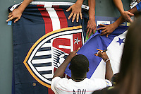 Freddy Adu signs flags for fans. USA defeated Grenada 4-0 during the First Round of the 2009 CONCACAF Gold Cup at Qwest Field in Seattle, Washington on July 4, 2009.