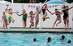 SOUTHBURY, CT--- -073115JS05--A group of girls jump into the water during the Nautical Night pool party at the Southbury town pool at Ballantine Park in Southbury. More than 150 middle school age kids showed up for swimming, games and food. The pool will host a Family Movie Night on Monday with events starting at 5:30 and the movie Frozen being shown at around 7:30.  <br />  Jim Shannon Republican-American