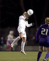 """Boston College midfielder Kate McCarthy (21) heads the ball. In overtime, Boston College defeated University of Washington, 1-0, in NCAA tournament """"Elite 8"""" match at Newton Soccer Field, Newton, MA, on November 27, 2010."""