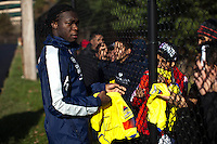 Felipe Caicedo of Ecuador, gives autographs after a practice at the Monclair University, ahead of their friendly match against Argentina in New Jersey, Nov 14, 2013. VIEWpress/Eduardo Munoz Alvarez