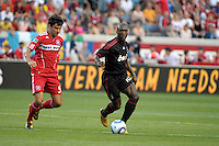 AC Milan midfielder Clarence Seedorf (10) dribbles away from Chicago Fire midfielder Baggio Husidic (9).  AC Milan defeated the Chicago Fire 1-0 at Toyota Park in Bridgeview, IL on May 30, 2010.