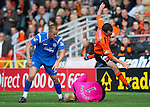 Dundee Utd v St Johnstone...25.09.10  .David Robertson goes flying as Peter Enckelman saves th ball.Picture by Graeme Hart..Copyright Perthshire Picture Agency.Tel: 01738 623350  Mobile: 07990 594431