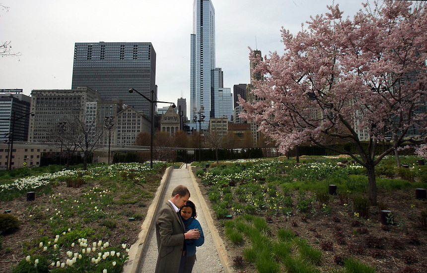 Boudewijn Blatter (l), of Holland, and Arianna Huerta, of Mexico, look at snaps they just took in the Lurie Gardens in Millennium Park, Monday, May 2, 2011, in Chicago. The tourists return to their home in Mexico City on the weekend. Photo by Charles Osgood