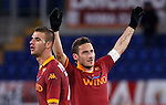 Calcio, Serie A: Roma vs Fiorentina. Roma, stadio Olimpico, 8 dicembre 2012..AS Roma forward Francesco Totti celebrates with teammate Panagiotis Tachtsidis, of Greece, left, after scoring his second goal during the Italian Serie A football match between AS Roma and Fiorentina at Rome's Olympic stadium, 8 december 2012..UPDATE IMAGES PRESS/Isabella Bonotto