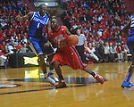 Ole Miss guard Chris Warren (12) is defended by Kentucky's Darius Miller (1) at the C.M. &quot;Tad&quot; Smith Coliseum in Oxford, Miss. on Tuesday, February 1, 2011. Ole Miss won 71-69.