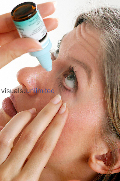 Woman with eye drops<br />