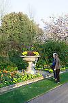 Two seniors enjoying the flowers in Avenue Gardens in Regent's Park, London, England