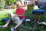 Lori of Los Altos sits with her pet poodle Mitch during the Blessing of the Pets service.