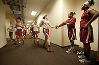 FRESNO, CA--Sara James gets encouragement from teammate Alex Green during warmups in the locker room hallway at the Save Mart Center for the 2012 NCAA Championships.