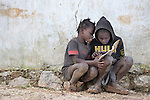 Children do their school homework in the mountainous community of Foret-des-Pins, Haiti.