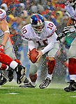 23 December 2007: New York Giants quarterback Eli Manning recovers his own fumble against the Buffalo Bills at Ralph Wilson Stadium in Orchard Park, NY. The Giants defeated the Bills 38-21. ..Mandatory Photo Credit: Ed Wolfstein Photo