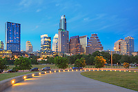 Looking north from the Long Center, this walkway appears to lead to downtown Austin, Texas, and the evening skyline. This photograph of the capitol city was taken on a mild June evening.