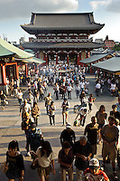 Tourists approaching the main hall of Sensoji temple, Asakusa, Tokyo, Japan, August 28, 2011. Sensoji is one of the oldest temples in Tokyo, and the shopping arcades around it have sold visitors souvenirs for centuries.