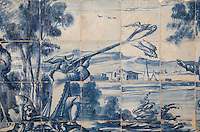 Hunting scene with man shooting birds, traditional blue and white azulejos tile scene, 18th century, part of a series depicting the history of the monastery and the Siege of Lisbon in 1147, in the Monastery of Sao Vicente de Fora, an Augustinian order monastery and church built in the 17th century in Mannerist style, Lisbon, Portugal. The monastery also contains the royal pantheon of the Braganza monarchs of Portugal. Picture by Manuel Cohen