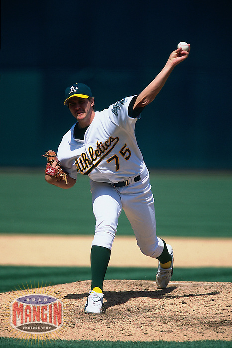 OAKLAND, CA - Barry Zito of the Oakland Athletics pitches during a game against the Anaheim Angels at the Oakland Coliseum in Oakland, California on April 20, 2002. Photo by Brad Mangin
