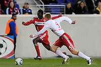 Patrick Nyarko (14) of the Chicago Fire is chased by Tim Ream (5) of the New York Red Bulls during the first half of a Major League Soccer match between the New York Red Bulls and the Chicago Fire at Red Bull Arena in Harrison, NJ, on March 27, 2010. The Red Bulls defeated the Fire 1-0.