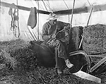Products: Horse Harness, saw, plow and pitchfork <br /> <br /> Jerome ID: Repairing equipment on the farm - 1909.   Brady Stewart and three friends went to Idaho on a lark from 1909 thru early 1912. As part of the Mondell Homestead Act, they received a land grant of 160 acres north of the Snake River.  The homesteaders set up a tent next to the farmhouse to keep feed, hay and equipment while the main house was under repair.  For 2 &frac12;  years, Brady Stewart photographed the adventures of farming along with the spectacular landscapes.