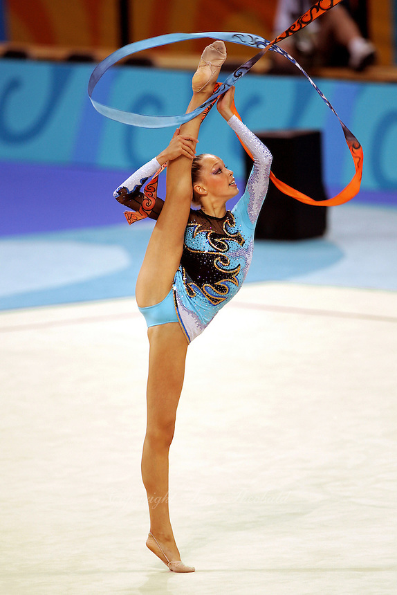 Dominika Cervenkova of Czech Republic turns pirouette with ribbon during qualifications round at 2004 Athens Olympic Games on August 27, 2006 at Athens, Greece. (Photo by Tom Theobald)
