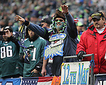 Seattle Seahawks fan cheers during a first quarter touchdown made against the Philadelphia Eagles<br /> at CenturyLink Field in Seattle, Washington on November 20, 2016.  Seahawks beat the Eagles 26-15.   &copy;2016. Jim Bryant Photo. All Rights Reserved.