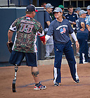 Sept. 29. 2013; Notre Dame Softball head coach Deanna Gumpf shakes hands with William &quot;Spanky&quot; Gibson after the game.<br /> <br /> Photo by Matt Cashore/University of Notre Dame