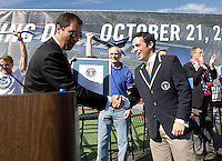 An official Guinness World Record adjudicator gives the world record award to Earthquakes club President Dave Kaval in front of the audience during Groundbreaking Ceremony at new stadium in Santa Clara, California on October 21st, 2012.  San Jose Earthquakes broke Guinness World Record for 6,256 people break ground on Quakes' new stadium.