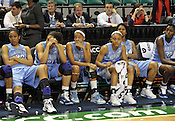 Disapointed UNC players watch the post-game celebrations from the bench. This was the Championship game of the 2011 ACC Tournament in Greensboro on March 6, 2011. Duke beat UNC 81-66. (Photo by Al Drago)