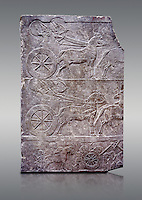 Stone relief sculptured panel of aa Assyrian Chariot. From the palace of Ashurnasirpal II  room VI/T1, Niniveh, third quarter of the 8th century BC. inv 19909  Louvre Museum , Paris
